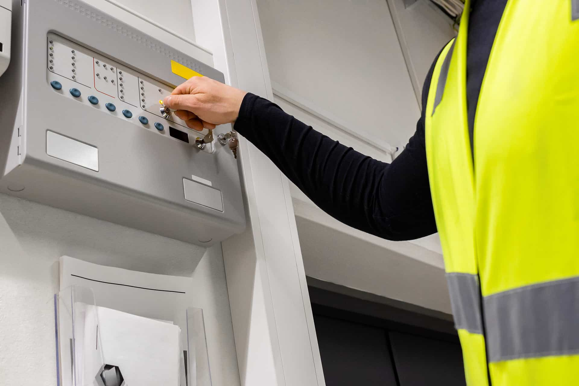Fire and Life Safety Director operating a fire alarm system