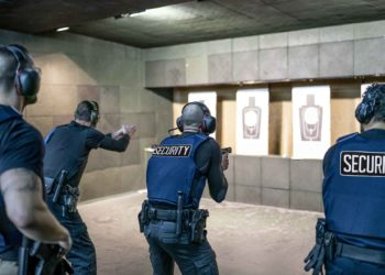 Armed security guards at a shooting practice